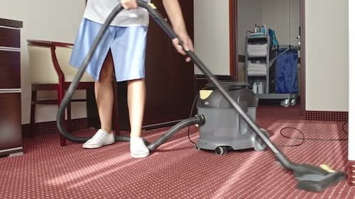 Cleaning Lady Vacuuming Room