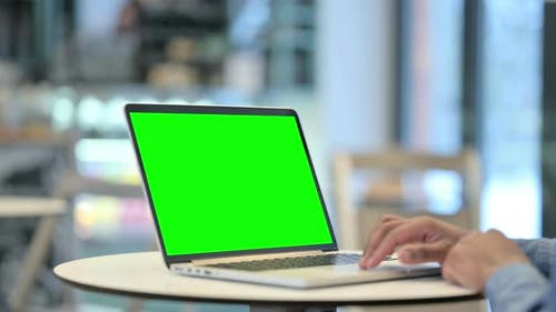 Man Using Laptop with Green Chroma Key Screen Close Up