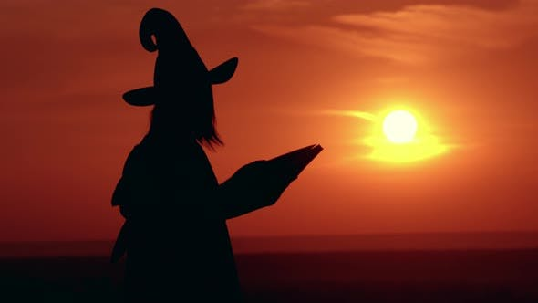 Thumbnail for Girl in Fancy Dress and Hat Witch Casts a Spell Sunrise View
