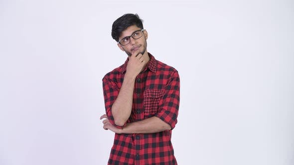 Thumbnail for Young Handsome Bearded Indian Hipster Man Thinking