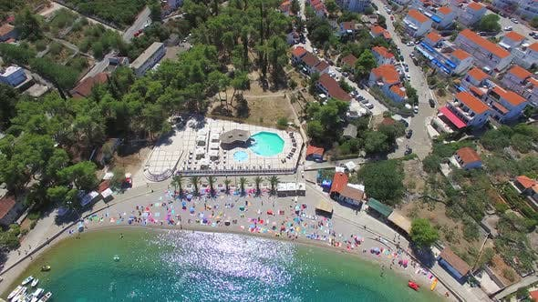 Thumbnail for View from above of sandy beach with palms and towels, Solta island, Croatia