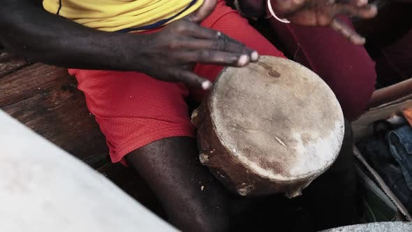 Local Africans Playing Drums on Traditional Dhow Boat at Trip Zanzibar