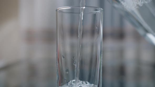 Pouring Clean Drinking Water Into Glasses, Camera Movement, Close-up