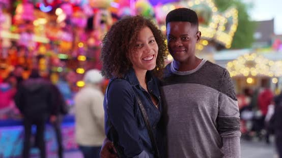 Thumbnail for Happy African American couple at the carnival pose for a portrait