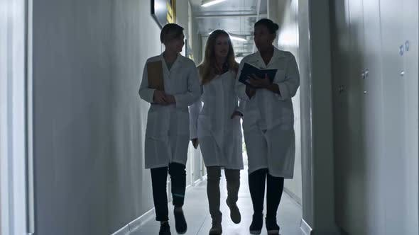 Thumbnail for Professional Female Engineers Going through Corridor