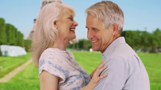 Thumbnail for Happy retired couple hug near the Eiffel Tower