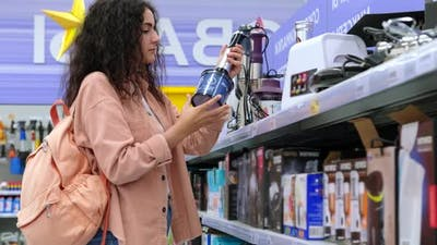 Woman is Shopping in Department of Home Appliances Choosing Blender