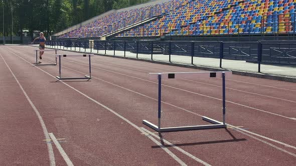 Thumbnail for Sportive Blonde Learning to Overcome All Difficulties on Life Path Hurdle Race