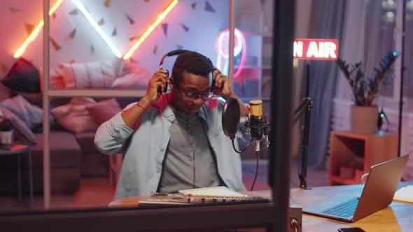 Thumbnail for Cheerful Black Man Hosting Radio Show in Home Studio