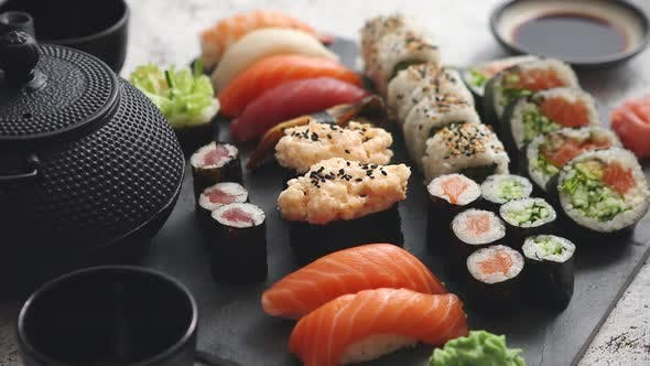 Thumbnail for Assortment of Different Kinds of Sushi Rolls Placed on Black Stone Board