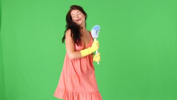 Thumbnail for Cute young woman dancing with toilet brush and sponge