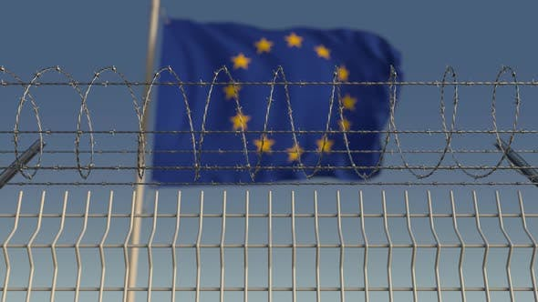 Thumbnail for Defocused Waving Flag of EU Behind Barbed Wire Fence
