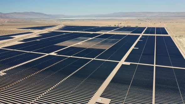 Thumbnail for Cinematic  Aerial View From Drone of Big Solar Power Fields in Vast Landscape