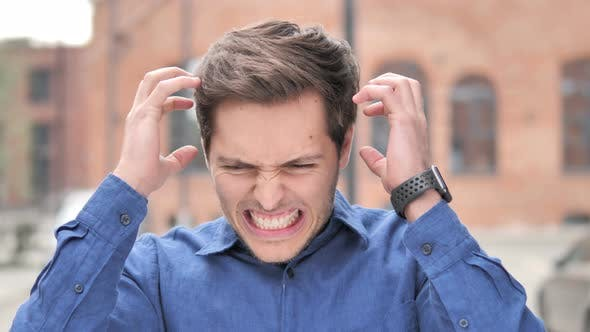Thumbnail for Outdoor Standing Angry Young Man Screaming in Frustration