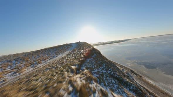 Plateau on the West Coast Beach and Sun Shining Brightly Against Blue Sky