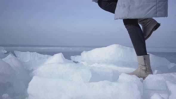 Thumbnail for Legs of Unrecognizable Woman in Warm Jacket and Boots Climbing the Glacier, Walking on the Edge