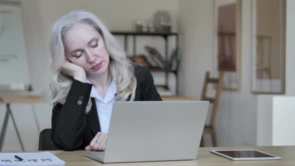 Thumbnail for Middle Aged Businesswoman Sleeping at Work