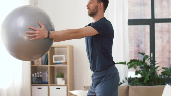 Thumbnail for Man Exercising and Doing Squats with Ball at Home
