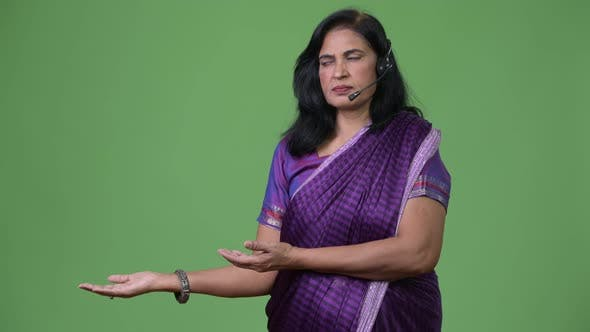 Thumbnail for Mature Beautiful Indian Woman As Call Center Representative Showing Something
