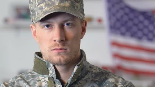 Confident Serviceman Looking Camera, National Flag on Background, American Army