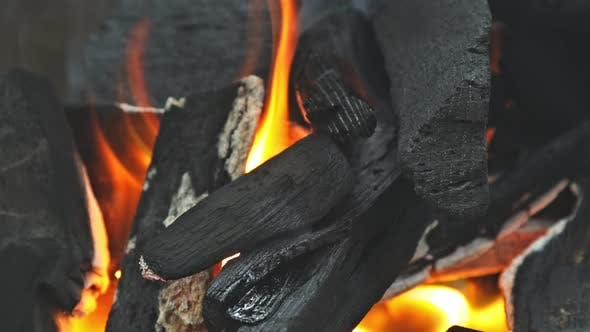 Preparation for Barbecue on Burning Coal in Iron Brazier