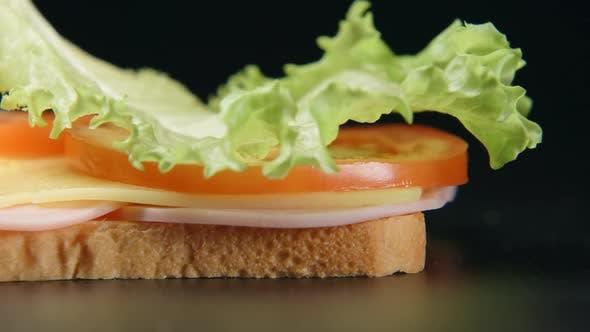Falling Of Ingredients On A Sandwich