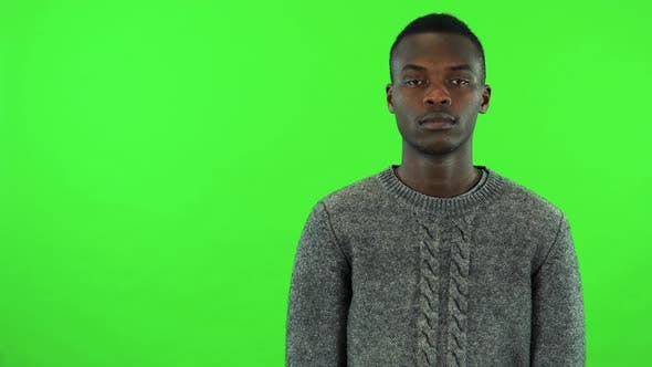 Thumbnail for A Young Black Man Looks at the Camera - Green Screen Studio
