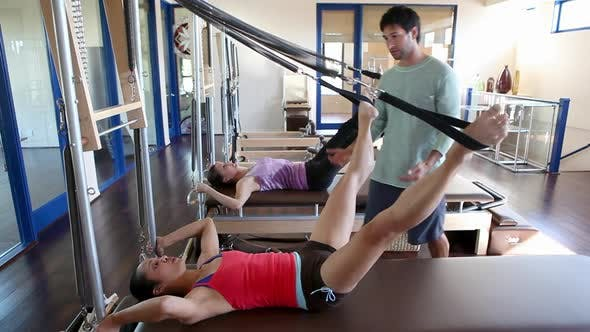 Thumbnail for Two women doing pilates with male instructor