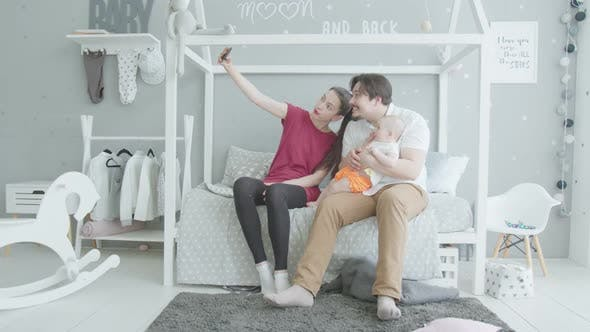 Thumbnail for Happy Family with Baby Taking Joint Selfie at Home