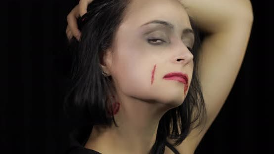 Thumbnail for Vampire Halloween Makeup. Woman Portrait with Blood on Her Face.
