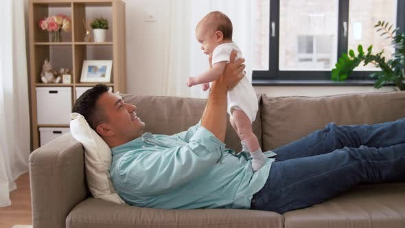 Cover Image for Middle Aged Father with Baby Daughter at Home