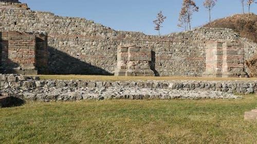 GAMZIGRAD, SERBIA - DECEMBER 25, 2017  Slow tilt on Felix Romuliana palace built by Roman Emperor Ga