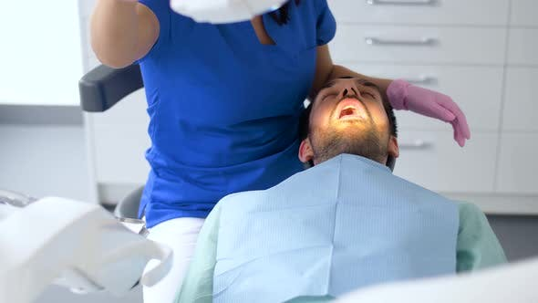 Cover Image for Dentist Checking Patient Teeth at Dental Clinic