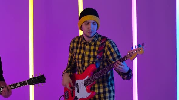 Thumbnail for The Performance of a Musical Group in a Studio Illuminated By Multicolored Neon Lamps