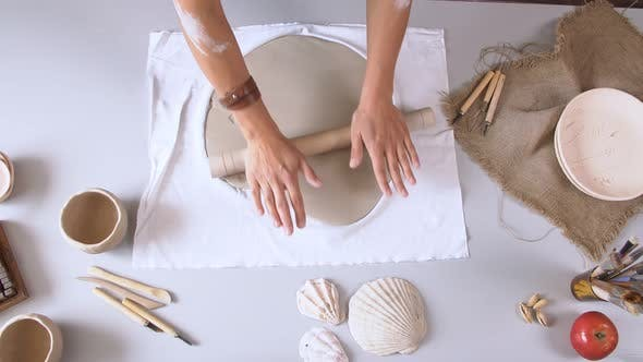 Thumbnail for Close Up Woman Rolling Clay Craftsman Skill Concept.