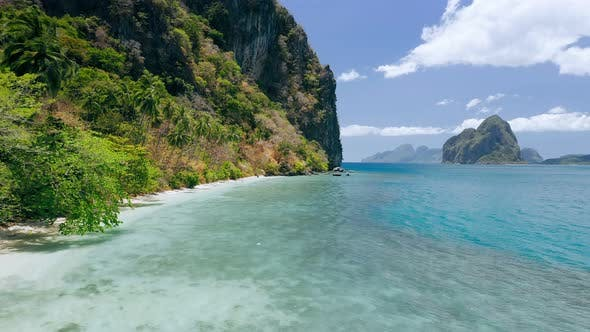 Thumbnail for Drone View of Paradise Beach and Steep Cliffs of Lagen Island. El Nido, Palawan, Philippines