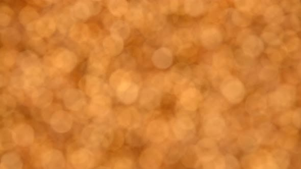 Thumbnail for Abstract background of golden bokeh spinning