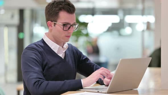 Thumbnail for Young Businessman with Laptop Saying No with Finger Sign