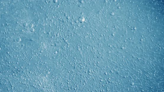 Oxygen Bubbles in Water on a Blue Abstract Background