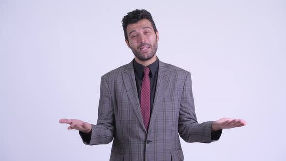 Thumbnail for Confused Bearded Persian Businessman Shrugging Shoulders