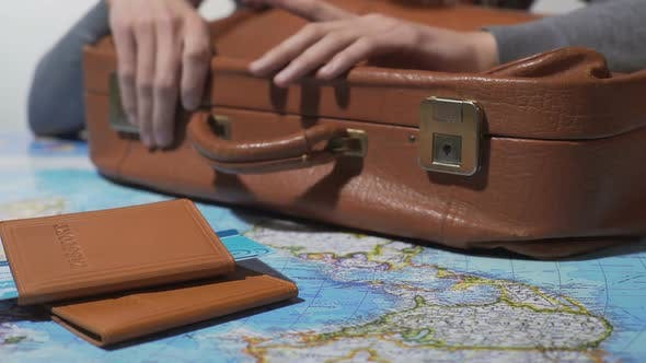 Thumbnail for Tourist Ready for Vacation Tapping Fingers on Old Suitcase, Travel Around World