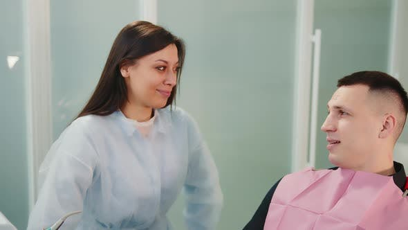Young Doctor Trainee Communicating with a Male Patient
