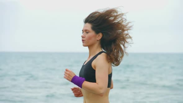 Thumbnail for Beautiful Young Female Athlete Running Outdoors, Training for Sports Competition