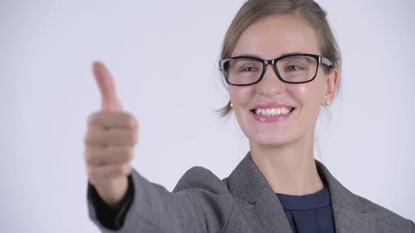 Thumbnail for Face of Young Happy Businesswoman Giving Thumbs Up