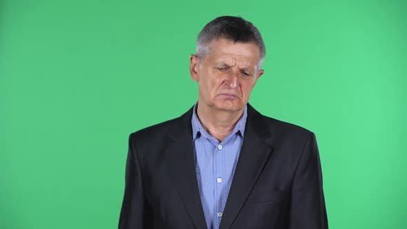 Thumbnail for Portrait of Aged Man Is Upset Isolated Over Green Background