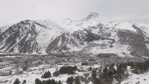 Aerial view of beautiful snowy mountains in Stepantsminda, Georgia