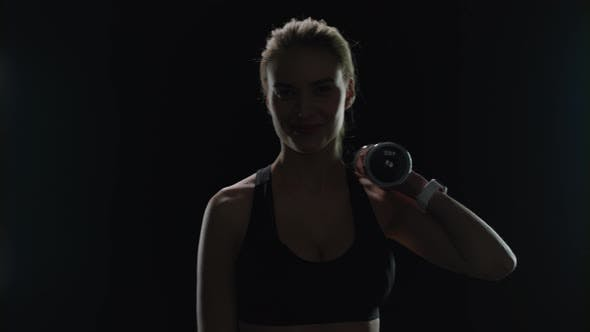 Thumbnail for Sport Woman Smiling with Dumbbell on Shoulder in Gym. Fitness Model Smiling