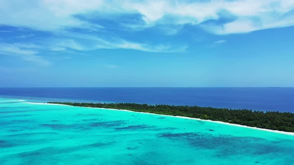 Wide aerial island view of a sunshine white sandy paradise beach and aqua turquoise water background