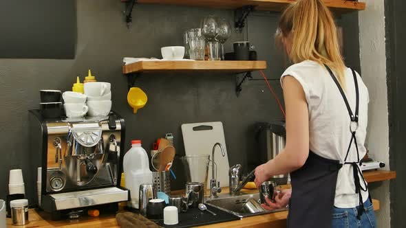 Thumbnail for Young Female Barista Washing Dishes at Workplace