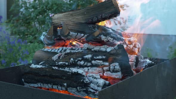 Thumbnail for Make fire flames from firewoods for grill. Flaming backyard charcoal. Bonfire for grill or BBQ